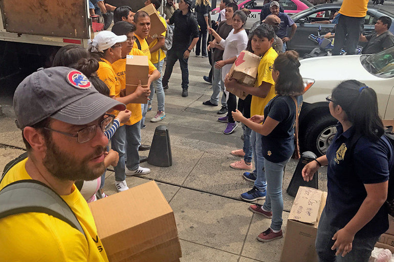 Distributing supplies collected by the Church of Scientology