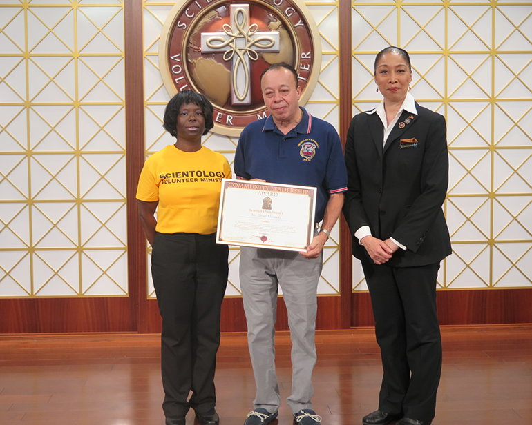 Mr. Israel Miranda of the New York City Emergency Medical Service is presented the Community Leadership Award by the Church of Scientology Harlem.